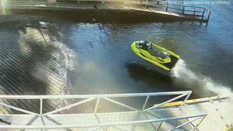 Security camera videos shows an out-of-control jet ski narrowly missing a man running near a boat ramp in Australia.