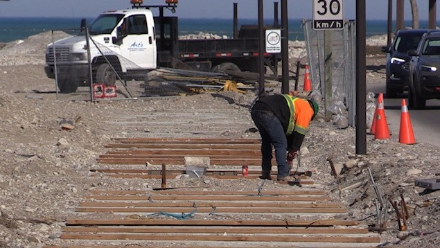 A worker completes repairs to the Goderich Ont. boardwalk on March 30, 2021. (Scott Miller/CTV London)