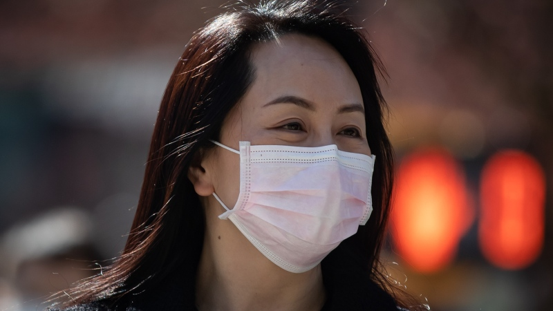 Meng Wanzhou, chief financial officer of Huawei, returns to B.C. Supreme Court after a break in her extradition hearing, in Vancouver, on Monday, March 29, 2021. THE CANADIAN PRESS/Darryl Dyck