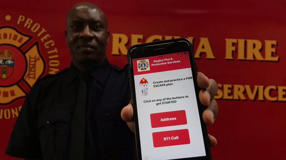 Loly Shalishali, a public education officer with Regina Fire and Protective Services, displays the new Regina - Fire 911 Education app. (Stefanie Davis / CTV News Regina)