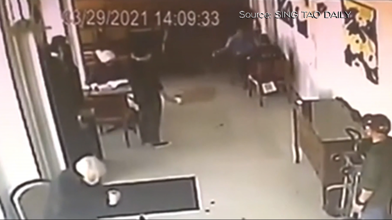 Security video shows drinks being poured onto the floor of a Richmond, B.C., coffee shop on March 29, 2021.