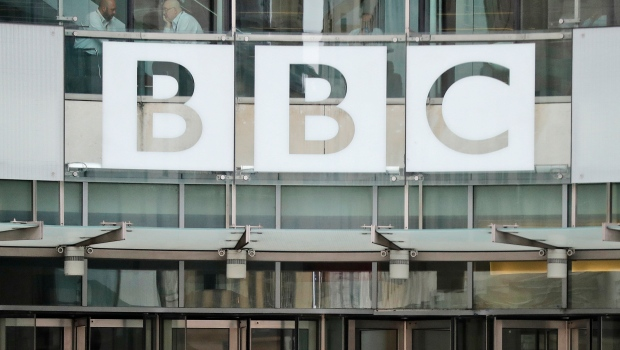 In this file photo dated Wednesday, July 19, 2017, The BBC sign outside the entrance to the headquarters of the publicly funded media organization in London. (AP Photo/Frank Augstein, FILE)
