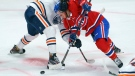 Montreal Canadiens' Jake Evans faces off against Edmonton Oilers' Jujhar Khaira during third period NHL hockey action in Montreal on Tuesday, March 30, 2021. THE CANADIAN PRESS/Paul Chiasson