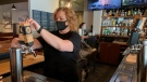 A restaurant employee works during the COVID-19 pandemic (Natalie van Rooy / CTV News Kitchener)