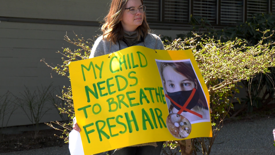 A parent opposed to B.C.'s mask mandate in schools takes part in a rally in Abbotsford on Wednesday, March 31, 2021.