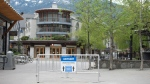 A physical distancing sign is pictured along the empty sidewalks in Whistler, B.C., Friday, May 15, 2020. (Jonathan Hayward / THE CANADIAN PRESS)