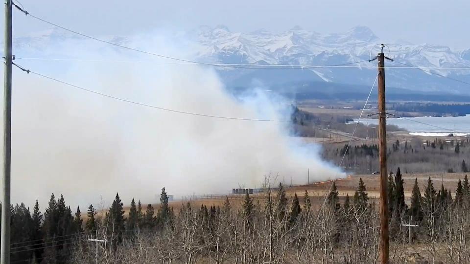 Grass fire, Cochrane, Highway 1A