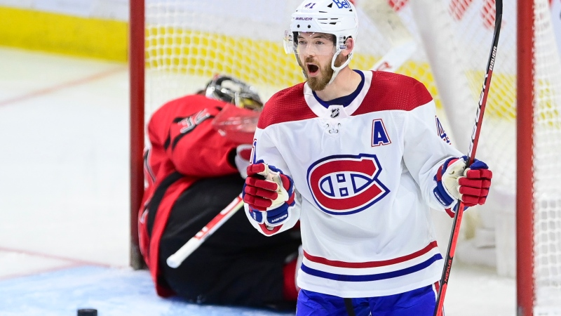 Montreal Canadiens' Paul Byron (41) celebrates a shorthanded goal on Ottawa Senators goalie Filip Gustavsson (32) during second period NHL action in Ottawa on Thursday, April 1, 2021. THE CANADIAN PRESS/Sean Kilpatrick