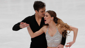 Tina Garabedian and Simon Proulx Senecal perform during the pairs Ice dance short program at the Figure Skating World Championships in Assago, near Milan, Friday, March 23, 2018. (AP Photo/Antonio Calanni)