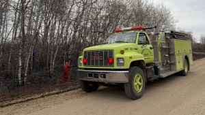 Carberry North-Cypress Fire Department combs the land about 12 kilometres west of Carberry on April 2, 202, where a day earlier a grass fire had set fields ablaze. (Source: Danton Unger/ CTV News Winnipeg)