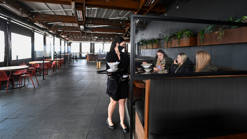 Food is served to a table on the outdoor patio at Joey Don Mills Grill and Lounge on April 1, 2021. THE CANADIAN PRESS/Nathan Denette