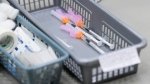 A basket of needles containing Pfizer-BioNtech COVID-19 vaccine waits to be administered to patients at a COVID-19 clinic in Ottawa on Tuesday, March 30, 2021. THE CANADIAN PRESS/Sean Kilpatrick