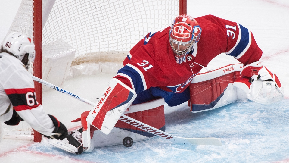 Carey Price stops a shot against the Sens