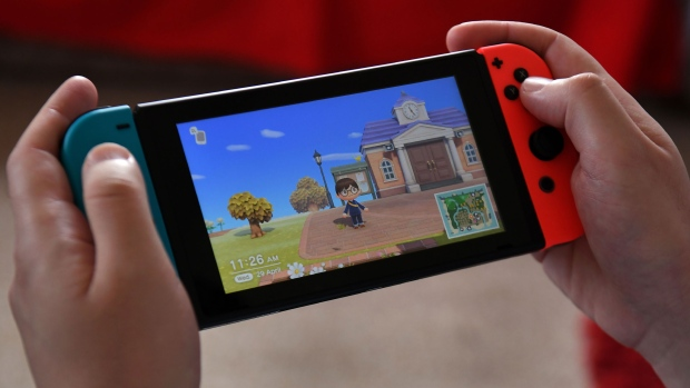 """A person plays Nintendo's """"Animal Crossing"""" on a Nintendo Switch system. It's no surprise that the pandemic has led to a surge of hobbies. What's interesting, some experts say, is that the surge mirrors what happened during the Great Depression. (William West/AFP/Getty Images)"""