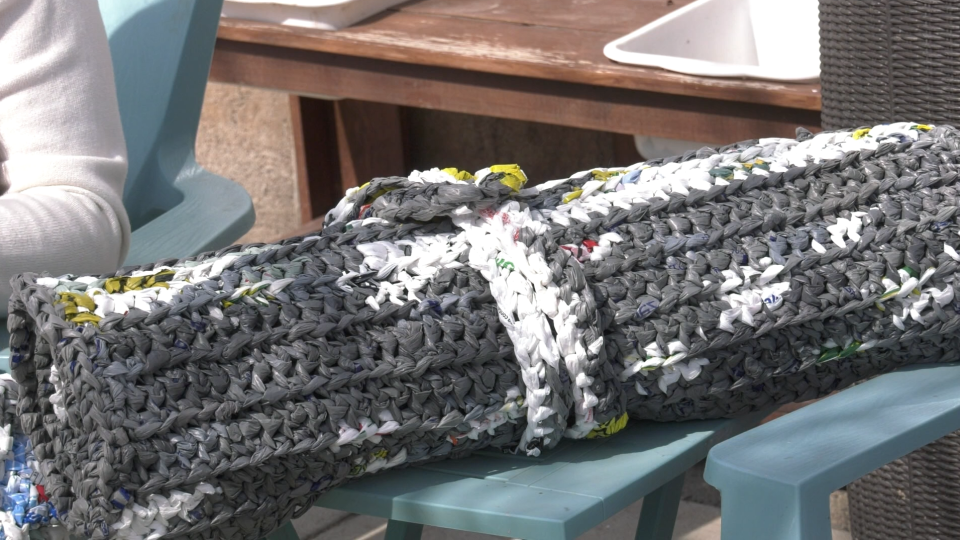 Plastic bags woven together to make a mat