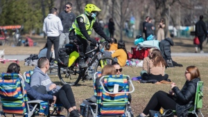 Police patrol a park inspecting gatherings in Montreal, Sunday, April 4, 2021, as the COVID-19 pandemic continues in Canada and around the world. THE CANADIAN PRESS/Graham Hughes