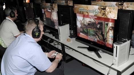 Attendees play 'Call of Duty: Modern Warfare 2,' at the multiplayer preview event hosted by Xbox 360 and Activision in Los Angeles, Tuesday, Sept. 15, 2009. (AP / Xbox, Dan Steiberg)