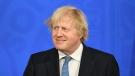 Britain's Prime Minister Boris Johnson pauses, during a coronavirus briefing in Downing Street, London, Monday April 5, 2021. (Stefan Rousseau/Pool via AP)