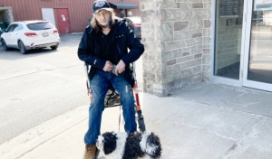 Steve Lane and his dog Charlie live in the building at 495 Notre Dame Ave. He said on March 23, he was given an eviction notice giving him one week to get out. (Alana Everson/CTV News)