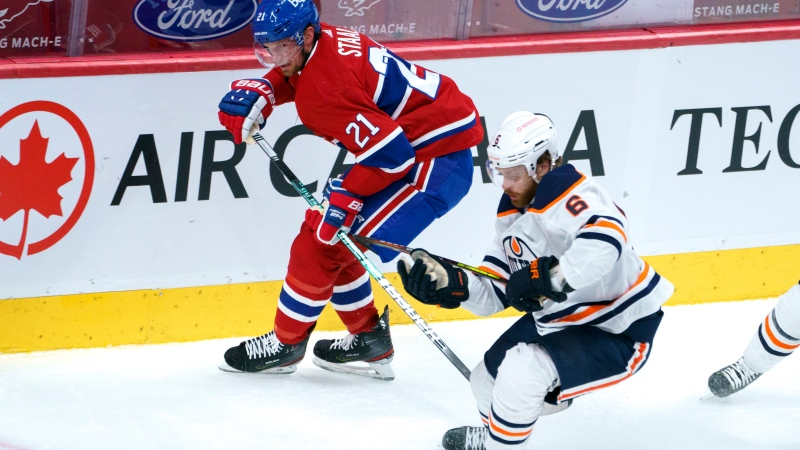Montreal Canadiens' Eric Staal clears the puck away from Edmonton Oilers' Adam Larsson during first period NHL hockey action in Montreal on Monday, April 5, 2021. THE CANADIAN PRESS/Paul Chiasson