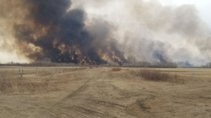 A wildfire estimated to be about 400 acres large is burning near Zhoda, Manitoba, on April 5, 2021. (Submitted: Bert Baumgartner)