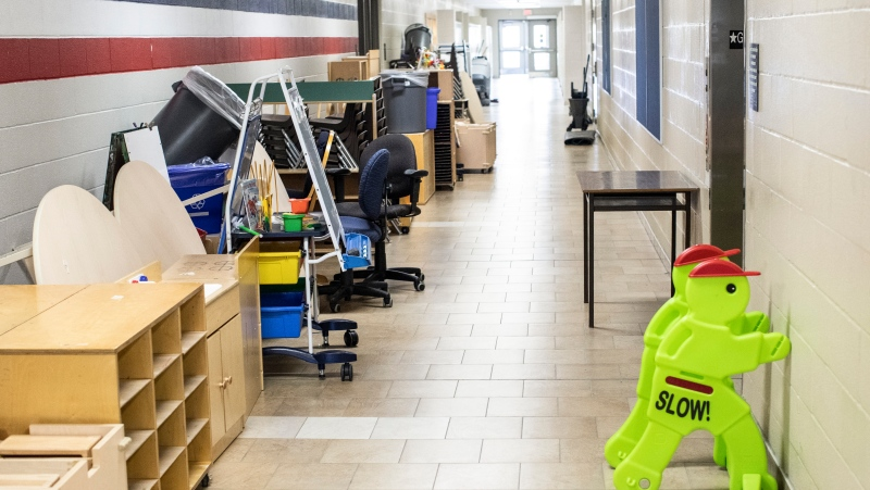 Furniture stands in a corridor at a school in Brampton, Ontario, on Thursday July 23, 2020. THE CANADIAN PRESS/Chris Young