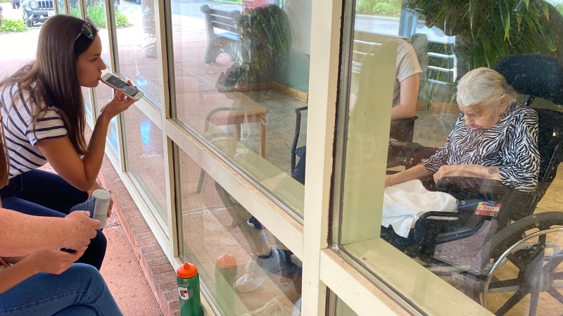 Sophia Holowaty would frequently visit her great-grandmother through the window outside the Ukrainian Canadian Care Centre in Toronto, taken on July 14, 2020. (Courtesy of Sophia Holowaty)