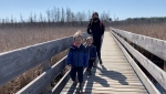 Jeanne Chan with her children Gavin and Blake, are discovering nature along the Mer Bleue Bog boardwalk, part of the NCC Greenbelt trail system. Ottawa, On. Apr. 5, 2020. (Tyler Fleming / CTV News Ottawa)
