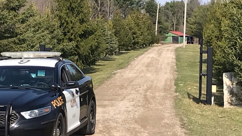 An OPP cruiser sits at the entrance of a home on Duff Line, in Dutton-Dunwich, Ont. on April 6, 2021. (Sean Irvine / CTV News)
