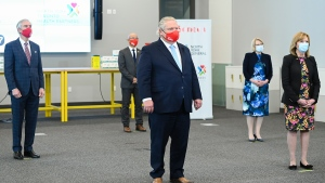 Ontario Premier Doug Ford gets ready to answer questions from the media at the Seneca College mass vaccination site during the COVID-19 pandemic in Toronto on Tuesday, April 6, 2021. THE CANADIAN PRESS/Nathan Denette
