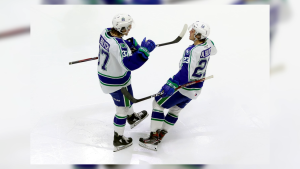 Brothers Kaleb and Aiden Bulych celebrate a goal with the Swift Current Broncos, the two are embracing the opportunity as teammates (Courtesy: Keith Hershmiller)
