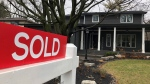 A real estate sold sign is shown in Oakville, Ont., on Sunday, Dec.20, 2020. A topsy-turvy real estate market has opened up new opportunities for first-time home buyers this year — but those seeking to take advantage still face major hurdles. THE CANADIAN PRESS/Richard Buchan