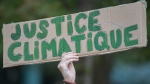 A person holds up a sign during a climate change protest in Montreal, Saturday, September 26, 2020. THE CANADIAN PRESS/Graham Hughes