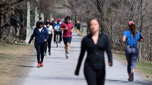People get outside on a sunny day in Ottawa on Wednesday, April 7, 2020. (Sean Kilpatrick/THE CANADIAN PRESS)