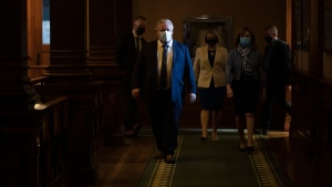 Ontario Premier Doug Ford makes his way to a news conference at the Queens Park Legislature in Toronto on Wednesday, April 7, 2021. The Province announced further lockdown restrictions in their latest effort to combat the spread of the COVID-19 virus. THE CANADIAN PRESS/Chris Young
