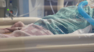 A patient lies in a hospital bed at Royal Victoria Regional Health Centre in Barrie, Ont. (Supplied)
