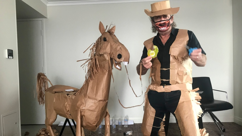 David Marriott poses with his paper horse 'Russell' in his hotel room in Brisbane, Australia, April 1, 2021. (David Marriott via AP)