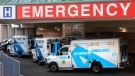 A paramedic closes the doors on his ambulance at a hospital in Toronto on Tuesday, April 6, 2021. THE CANADIAN PRESS/Frank Gunn