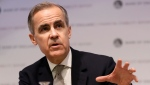 In this file photo dated Monday, Dec. 16, 2019, Mark Carney, Governor of the Bank of England speaks at a Bank of England Financial Stability Report Press Conference, in London. (AP Photo/Kirsty Wigglesworth, FILE)