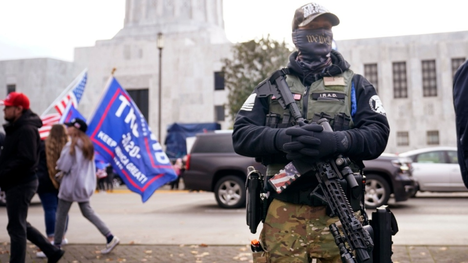 A man holds a gun at the Oregon State Capitol