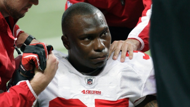 San Francisco 49ers cornerback Phillip Adams after injuring his left leg during an NFL football game against the St. Louis Rams, in St. Louis, on Dec. 26, 2010. (Tom Gannam / AP)