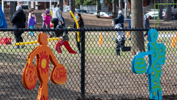 School children play in the yard of Adam Beck public school in Toronto on Tuesday, April 6, 2021. All Toronto District School Board schools will be closed to in person learning starting tomorrow. THE CANADIAN PRESS/Frank Gunn