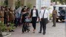 Mrs. World 2019 Caroline Jurie, centre, leaves a police station after obtaining bail in Colombo, Sri Lanka, on April 8, 2021. (Eranga Jayawardena / AP)