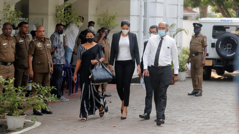 Mrs. World 2019 Caroline Jurie, centre, leaves a police station after obtaining bail in Colombo, Sri Lanka, on April 8, 2021.  (Eranga Jayawardena / AP)