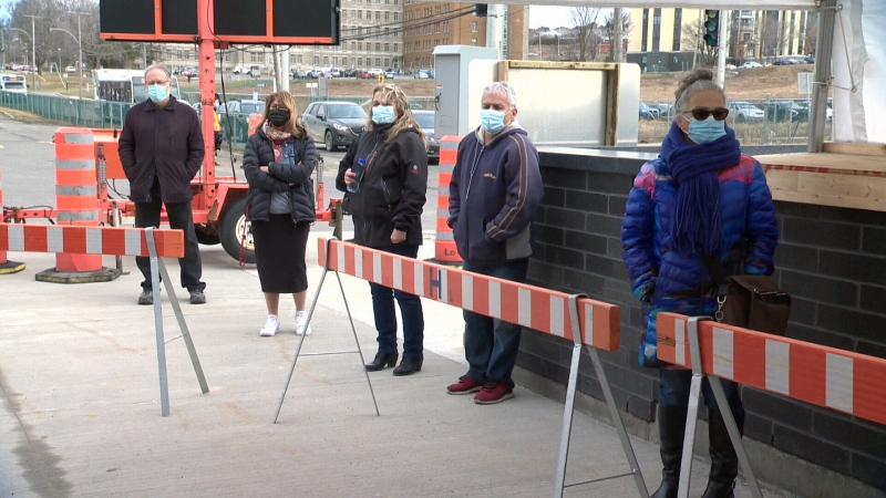 People line up outside a Quebec City vaccination clinic as the province lowers the minimum age to 55 for the AstraZeneca vaccine. (Samuel Pouliot, CTV News)