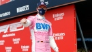 Driver Nico Hulkenberg of Germany celebrates setting the third fastest time during qualifying for the 70th Anniversary Formula One Grand Prix at the Silverstone circuit, Silverstone, England, Saturday, Aug. 8, 2020. (Andrew Boyers/Pool Photo via AP)