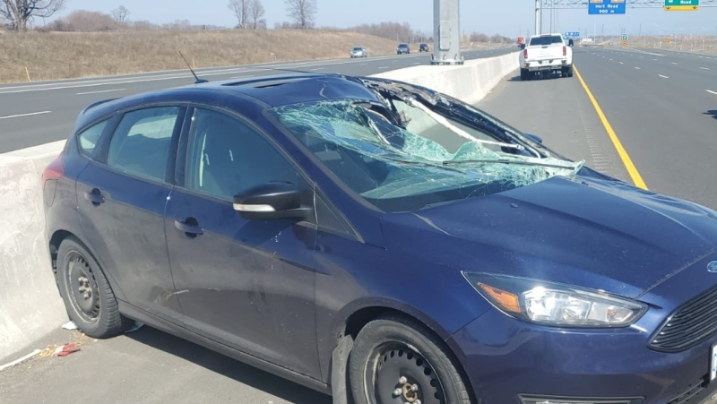 The windshield of a vehicle was smashed after it was hit by a bouncing wheel on Highway 401. (Twitter/OPP_HSD)