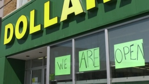 A dollar store in Barrie, Ont. posts an open sign during the stay-at-home order on April 8, 2021 (Rob Cooper/CTV News)