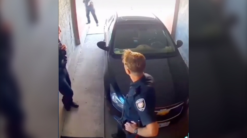 Ottawa police are investigating a security video from 2019 showing an officer in conversation with colleagues saying that 'white man's day is done,' before they appear to make several other comments on race. (Submitted)