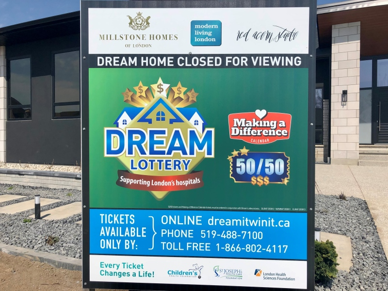 A sign explain some of the rules for the Dream Home Lottery in London, Ont. is seen Thursday, April 8, 2021. (Jim Knight / CTV News)